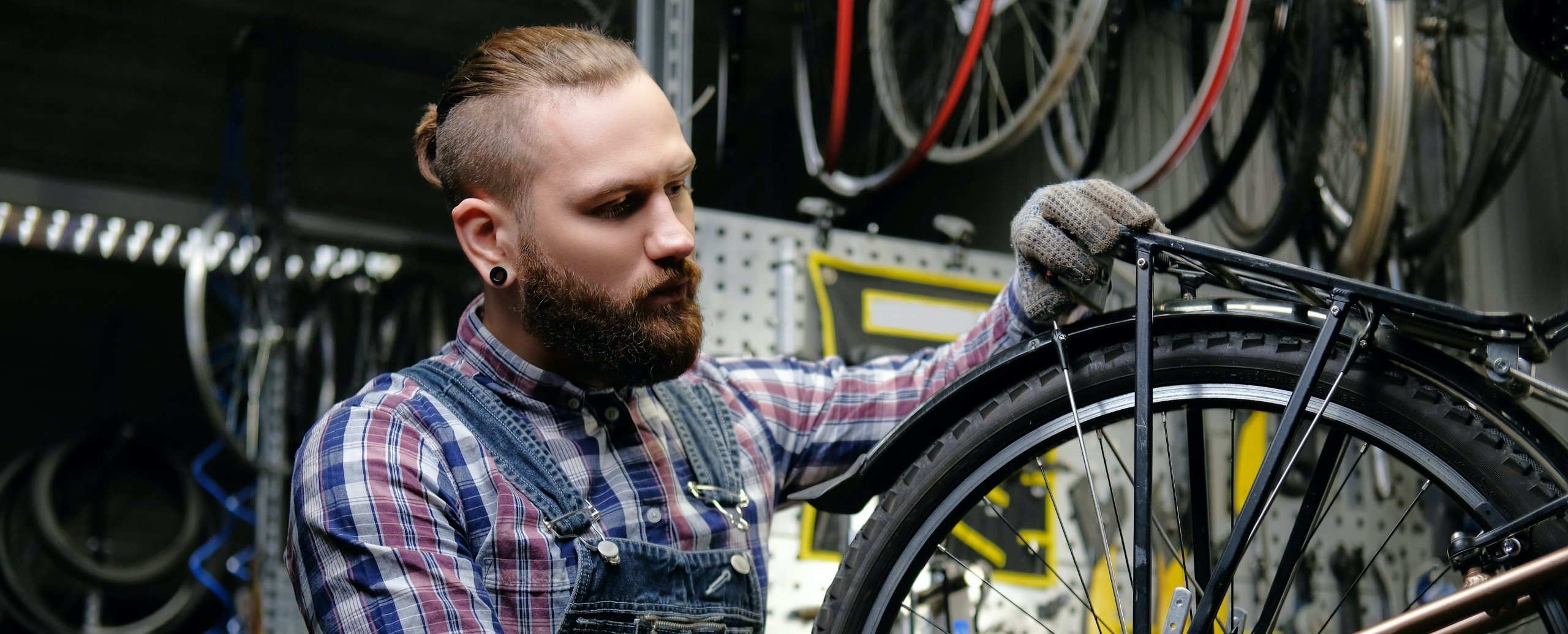 Man working on a bicycle in a bike shop